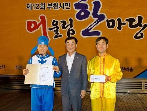 Последователи Фалуньгун заняли 1 место на фестивале в Южной Корее
